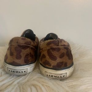 Faux cheetah slip on sneakers